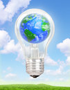 Planet Earth in a light bulb Royalty Free Stock Photo