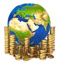 Planet Earth and a pile of gold coins Royalty Free Stock Photo