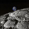 Planet earth rising view from the moon surface