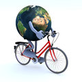 Planet earth riding a bycicle Stock Photos