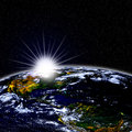 Planet earth in space with sunrise and stars Royalty Free Stock Photo