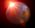 Planet earth with sunrise in dark Royalty Free Stock Photos