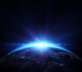 Planet earth with sunrise in the space Royalty Free Stock Photo