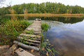 Planked footway on river in autumn time Stock Photo