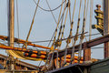 Planks, ropes, pulleys, tackle, and rigging of a replica of an old 1400's era sailing ship Royalty Free Stock Photo