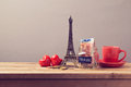 Planning romantic holiday vacation in paris france eiffel tower coffee cup and money box on wooden table Royalty Free Stock Images