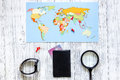 Planning trip. World map and bank card on wooden table background top view copyspace