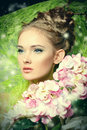 Plant clambering portrait of a beautiful girl with flowers spring Royalty Free Stock Photography