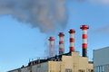 Plant emissions four striped industrial chimneys Stock Photography