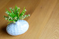 Plant in vase on wooden table a Royalty Free Stock Photography