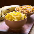 Plantain chips bowls of salty front and sweet back a popular snack in south america photographed with natural light selective Stock Photos