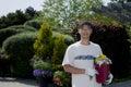 Planting senior man a sapling Stock Photo