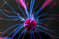 Plasma ball with magenta blue flames isolated on a black background Royalty Free Stock Photo