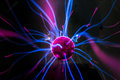 Plasma ball  with magenta-blue flames Royalty Free Stock Photo
