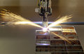 Plasma cutting process of metal material with sparks Stock Image
