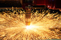 Plasma or laser cutting metalworking with sparks Royalty Free Stock Photo
