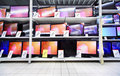 Plasma TVs stand on shelves in large store Royalty Free Stock Photo