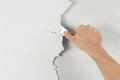 Plaster removal with hand and spatula Royalty Free Stock Images