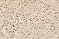 Plaster texture tawny of a house wall Royalty Free Stock Image