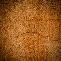 Plaster wall damaged grunge dirty dark and light brown or orange painted or Royalty Free Stock Photos