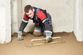 Plasterer concrete worker at floor work Royalty Free Stock Photos