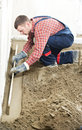 Plasterer concrete worker at floor work indoor cement topping with float Stock Image
