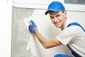 Plasterer at indoor wall work renovation decoration with float and plaster Stock Images