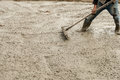 Plasterer screed concrete for floor of construction out site. Royalty Free Stock Photo