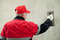Plasterer in uniform working with float Royalty Free Stock Images