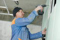 Plasterer worker with gypsum board Royalty Free Stock Photo