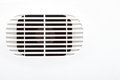 Plastic air vent in white wall ventilation grille Royalty Free Stock Photo