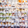 Plastic bags of fishes for sale at the market Royalty Free Stock Photo