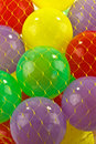 Plastic balls little red yellow green and mauve Stock Photos