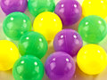 Plastic balls little yellow green and mauve Stock Images