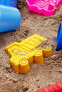 Plastic beach toys lying in sand Stock Photography