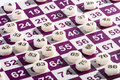 Plastic Bingo Numbers on Top of the Game Card Royalty Free Stock Photo