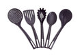 Plastic black cooking utensils on a light background Royalty Free Stock Photo