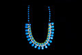 Plastic blue necklace Royalty Free Stock Photo