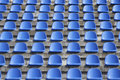 Plastic blue seats on football stadium Royalty Free Stock Photo