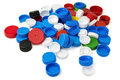 Plastic bottle caps colorful on white Royalty Free Stock Photo