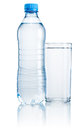 Plastic bottle and glass of drinking water isolated on white bac Royalty Free Stock Photo