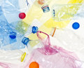 Plastic bottles and bags garbage colorful background Royalty Free Stock Images