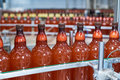 Plastic bottles with beer or carbonated beverage moving on conveyor