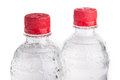 Plastic bottles of drinking water isolated on white Stock Image