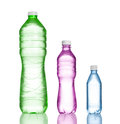 Plastic bottles three water on white Royalty Free Stock Image