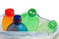 Plastic bottles in the trash on white background Royalty Free Stock Image