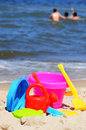 Plastic children toys on the beach sand Royalty Free Stock Photos