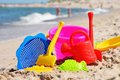 Plastic children toys on the beach sand Royalty Free Stock Images