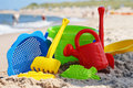 Plastic children toys on the beach sand Royalty Free Stock Image