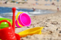 Plastic children toys on the beach sand Royalty Free Stock Photo
